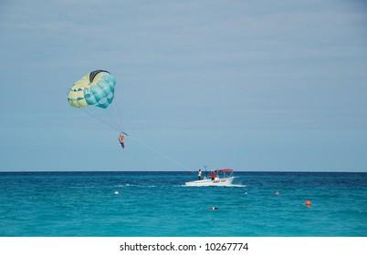 Para sailing against blue sky