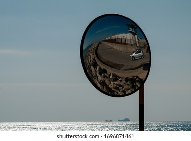 Parabolic mirror on a road for traffic safety.