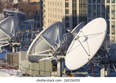 Parabolic satellite dish space technology receivers over the city, Toronto, Canada