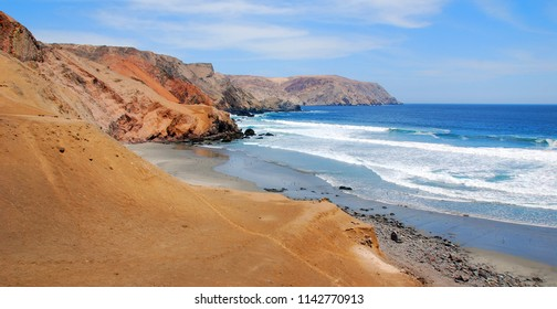 Paracas National Reserve where the Desert Meets Sea Coastline, Paracas National Reserve, Ica Region, Peru. Atacama desert in the Paracas National Reserve on the Pacific coast