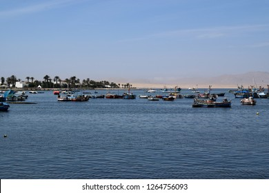 Paracas, Peru, December 5 2018: Fishing boats in the coast.