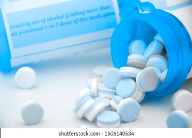 Paracetamol in blue and white plain compress tablets with caution on the bottle.