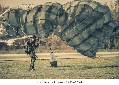 Parachute Attack Airborne , US Army paratroopers , Member of Red Star history club wears historical American paratrooper uniform during historical reenactment of WWII