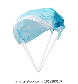 Parachute from a medical mask isolated on a white background. The concept of protection against coronavirus and other viruses
