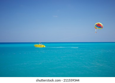 parachute on the high seas pulls powerboat/parachute on the high/parachute