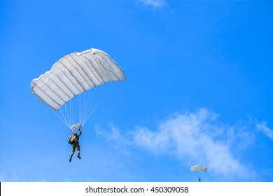 Parachute on white sky background