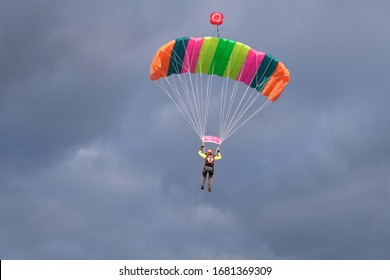 Parachute in the sky. Skydiver is landing.