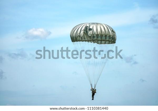 Parachute training with blue sky