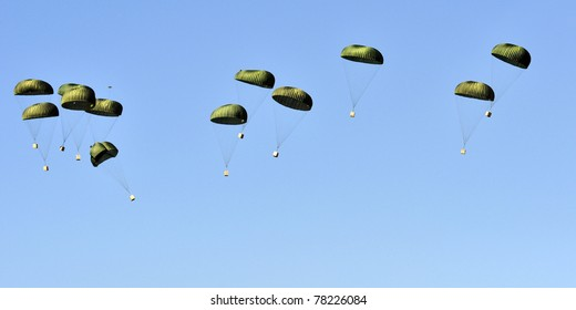Parachutes with military supplies.