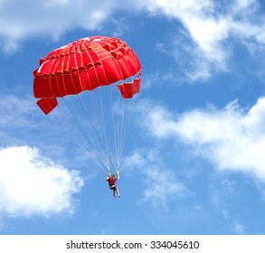 Parachuting over a sea, towing by a boat