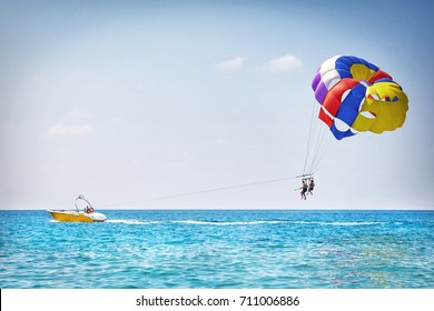 Parachuting in Turkey. Parasailing with boat over sea in Alanya in beautiful summer day. Tropical beach vacation