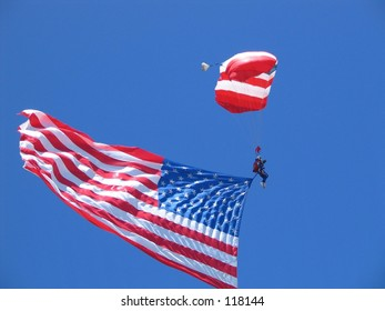 parachutist flying with the us flag