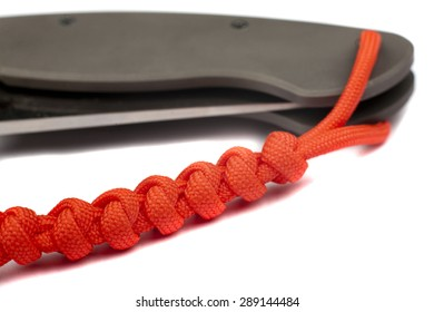 Paracord lanyard with knife on white background
