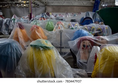 parade float heads under plastic cover