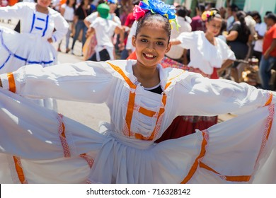 A parade participant shows her dress at the Honduras Independence Day parade at the town of La Lima, on September 15,2017.