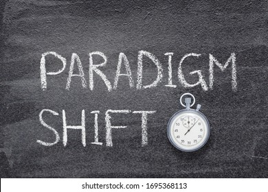 paradigm shift phrase written on chalkboard with vintage precise stopwatch