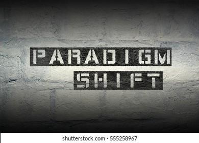 paradigm shift stencil print on the grunge white brick wall
