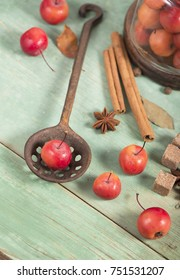 paradise apples, on the wooden table in the rustic style, iron mug