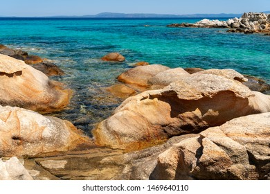 Paradise bay beach with rocks in water  , Chalkidiki, Greece