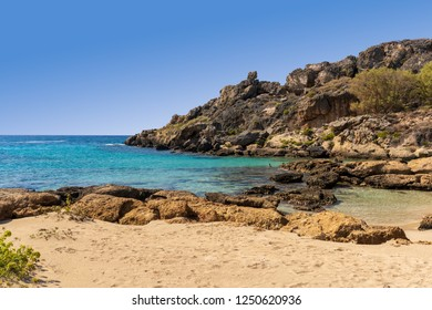 Paradise Bay at Elafonisi Beach with turquoise water, some rocks and sand on the island of Crete, Greece