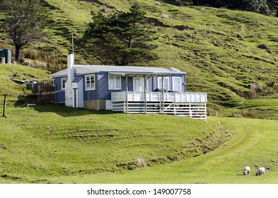 PARADISE BAY - NZ - AUG 06:Remote batch holiday house on Aug 06 2013 in Paradise bay, NZ. More than 50,000 baches exist around New Zealand and they are an iconic part of NZ history and culture