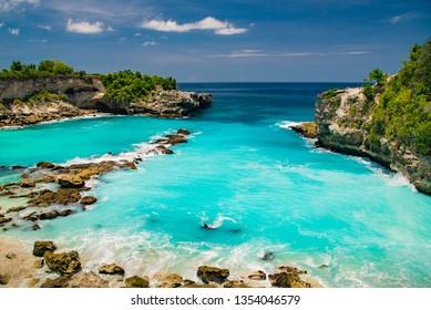 Paradise beach in Bali, blue lagoon, golden sand.