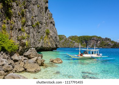 Paradise beach in El Nido - Palawan, Philippines. Traditional boat in the sea. Transparent turquoise sea water