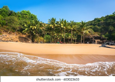 Paradise beach in Gokarna, India. Beautiful deserted landscape with clean sand and wave. View from the sea to the shore.