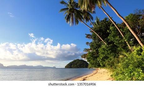 Paradise beach landscape - Las Cabanas beach in El Nido, Palawan island, Philippines.