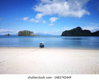 Paradise beach in Langkawi, Malaysia, with white beaches and clear blue waters. Perfect peaceful landscape on a beautiful summer day, providing the base for a holidy to come to a rest