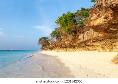 Paradise beach with rock and trees in summer. Luxury vacation travel holiday background concept, sabbatical.