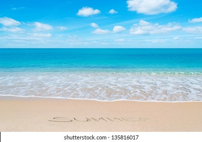 """paradise beach with """"summer"""" written in sand"""