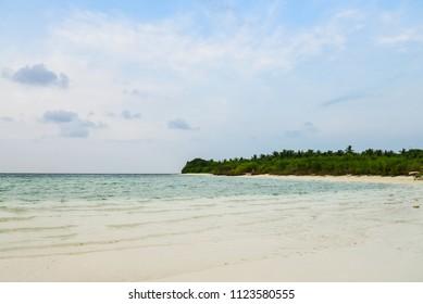 Paradise beach at sunny day on Fehendhoo island, Maldives