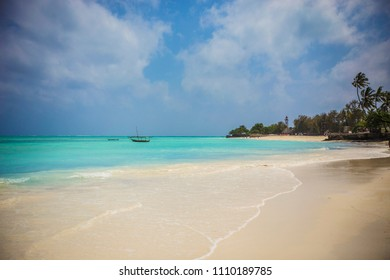 Paradise beach with turquoise water and boat in Nungwi village, Zanzibar, Tanzania