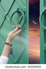 Paradise heaven . Way to Allah .  Sunset or sunrise with clouds, light rays and other atmospheric effect  . Ramadan   background .  The female hand, opens gate to heaven.