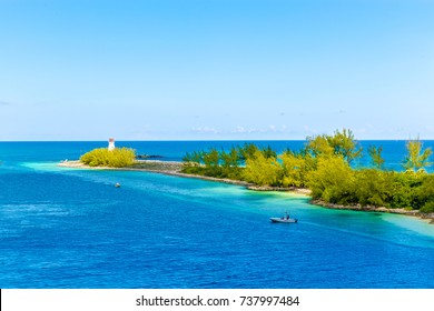 Paradise island lighthouse at Nassau, Bahamas. In the heart of the Caribbean sea in a sunny summer day. Caribbean beaches with white sand and deep blue sea Bahamas.