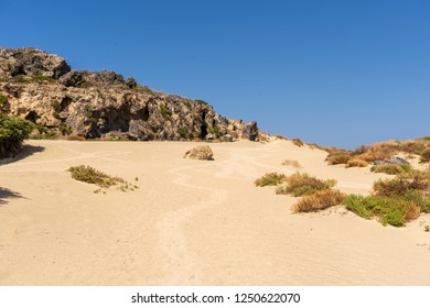 Paradise Landscape at Elafonisi Beach with sand, some rocks and a hill on the island of Crete, Greece