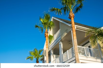 Paradise on Padre island old historic building with palm trees rising above beach vacation home