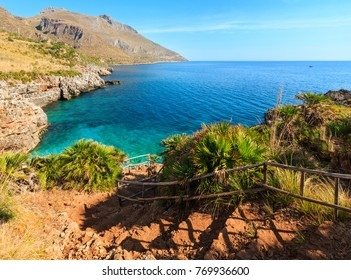 Paradise sea bay with azure water and beach  view from coastline trail of Zingaro Nature Reserve Park, between San Vito lo Capo and Scopello, Trapani province, Sicily, Italy