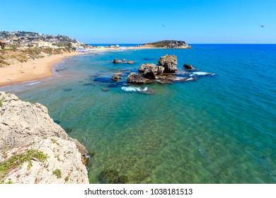 Paradise sea beach Cala Paradiso and Cala del Re near Rocca di San Nicola, Agrigento, Sicily, Italy. People unrecognizable.