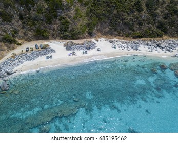 Paradise of the sub, beach with promontory overlooking the sea. Zambrone, Calabria, Italy. Diving relaxation and summer vacations. Italian coasts, beaches and rocks