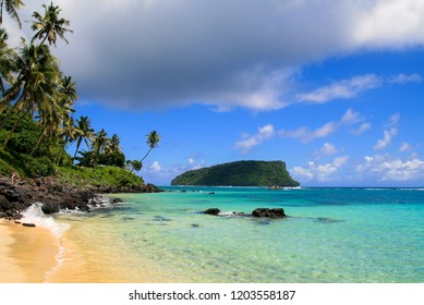 Paradise tropical beach in Pacific Ocean with turquoise water, golden sand and exotic palm trees. Idyllic holiday escape, view from Lalomanu beach in Upolu to Nu'utele island, Samoa