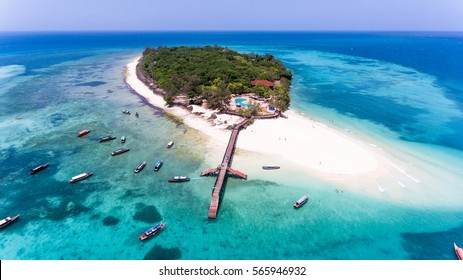 Paradise tropical island white beach, turquoise water, Zanzibar Prison island aerial view.