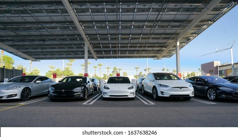 Paradise Valley, AZ / USA - January 3, 2020: Tesla cars charging at an urban supercharger located at Biltmore Fashion Park mall in Paradise Valley, AZ. This supercharger has 12 charging stations.