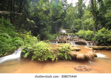 Paradise waterfall in Tropical rain forest of Thailand , water fall in deep forest at Tak province Thailand . The waterfall named Pha Charoen waterfall