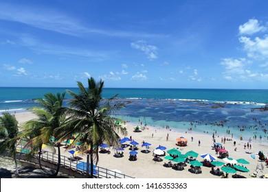 Paradisiac beach with crystal water. Brazillian Caribbean. Porto de Galinhas, Pernambuco, Brazil. Travel destination. Vacation travel.