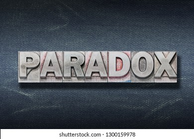 paradox word made from metallic letterpress on dark jeans background