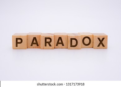 PARADOX Word Written In Wooden Cube