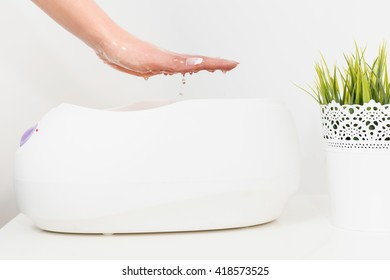 Paraffin wax bath treatment in beauty salon