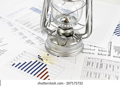 Parafin oil lamp on financial datas